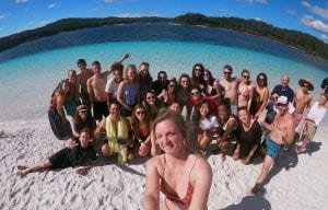 group of backpackers on fraser island, lake mckenzie
